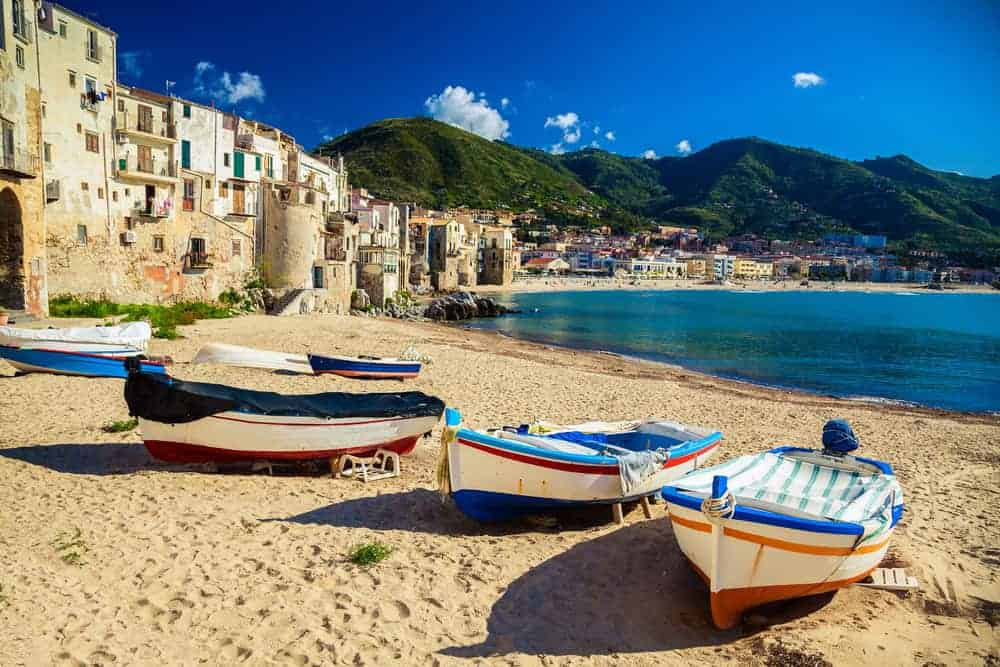 Where to find winter sun in Europe. Cefalu beach in Sicily.
