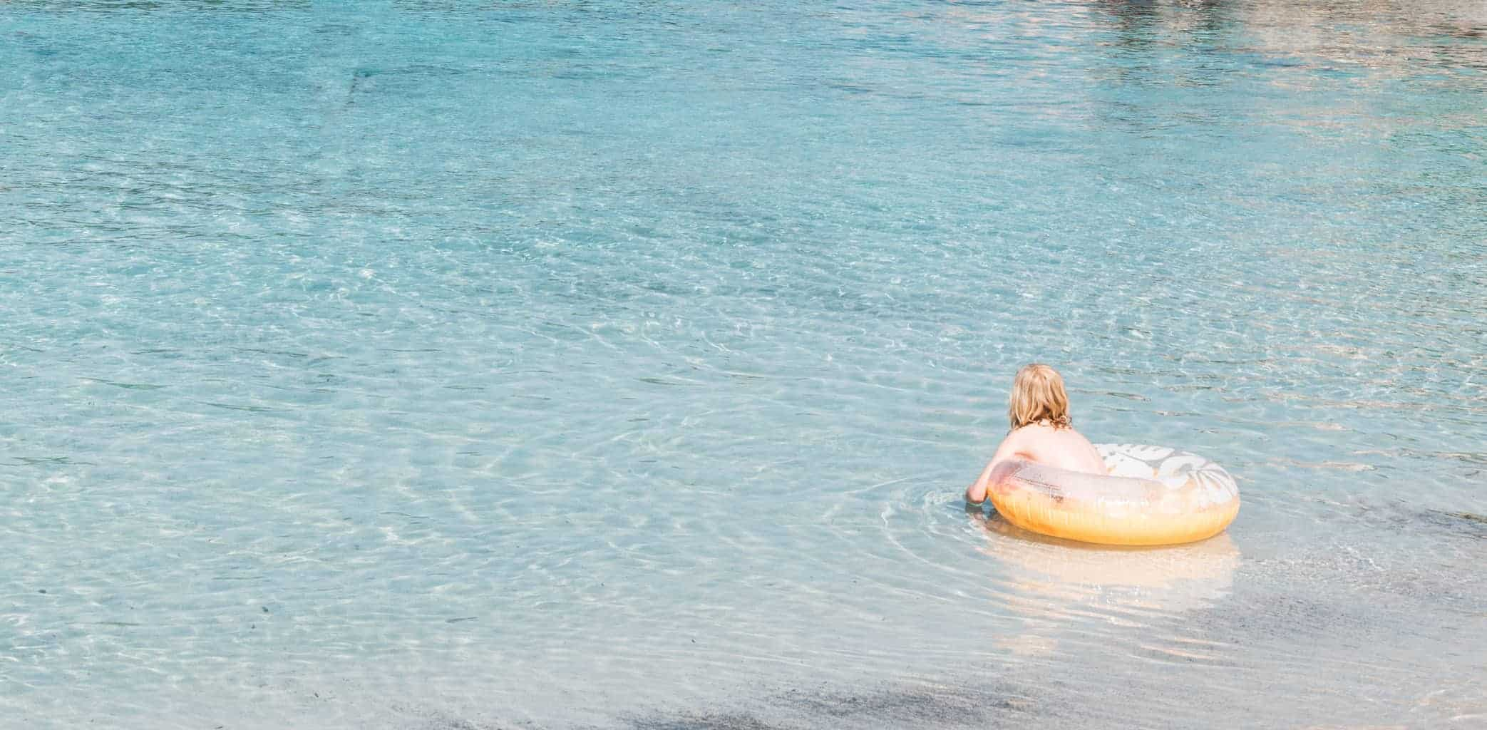 Girl swimming at S'Amarador beach in Mallorca