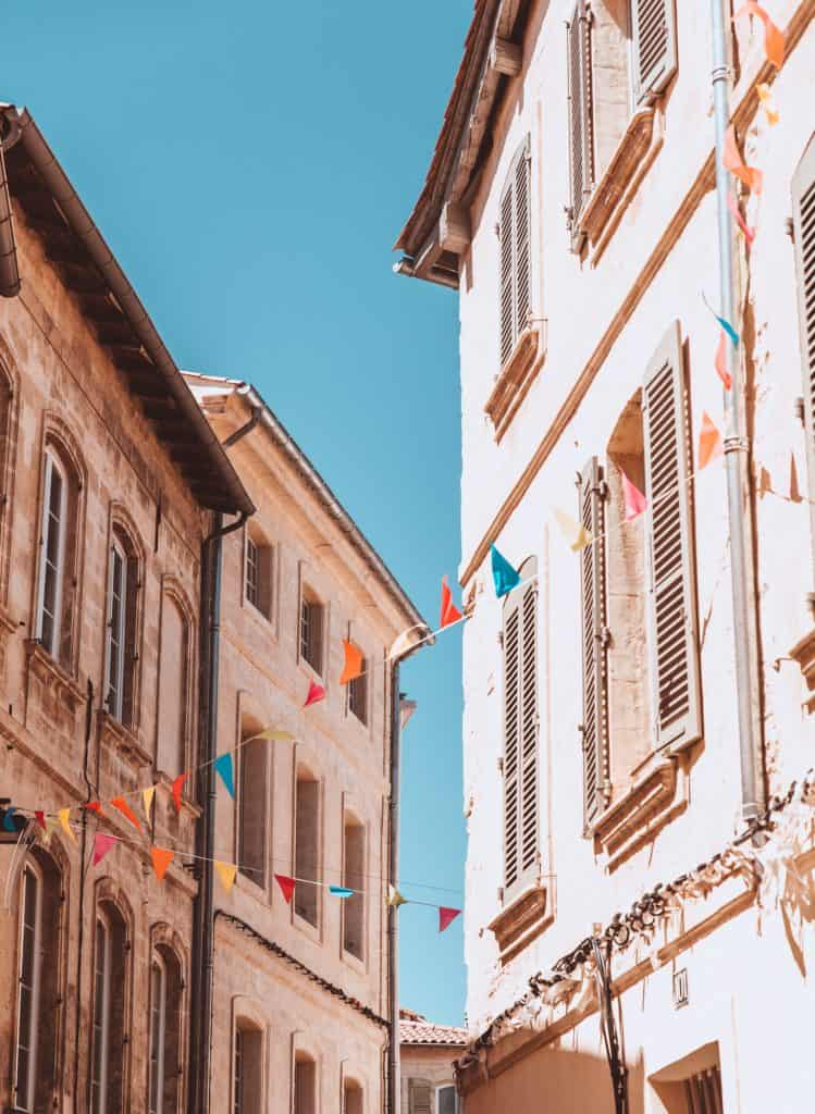 Avignon streets under a blue sky.