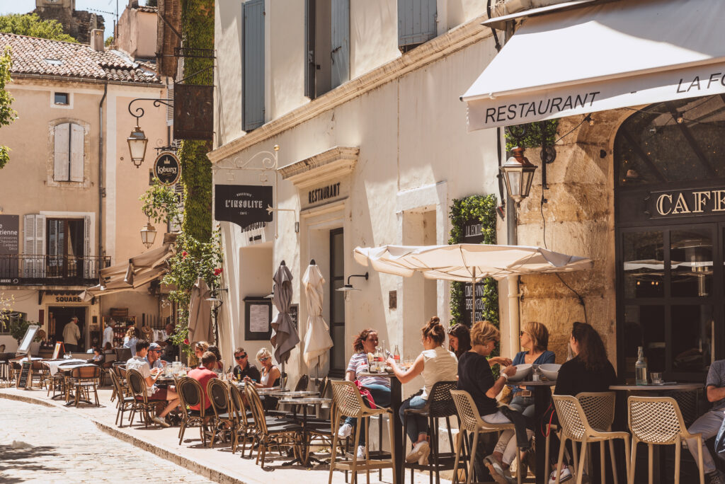The busy streets of Lourmarin village in Provence, France